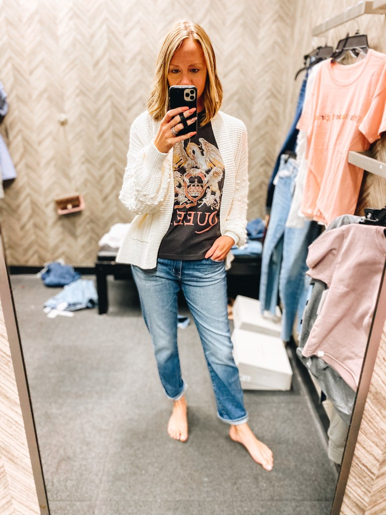 Nordstrom Anniversary Sale 2021: Try On Edition featured by top Pittsburgh fashion blogger, Fashionably Late Mom   Nordstrom Anniversary Sale by popular Pittsburgh fashion blog, Fashionably Late Mom: image of a woman wearing a Nordstrom cream knit cardigan, Queen graphic t-shirt, and light wash jeans.