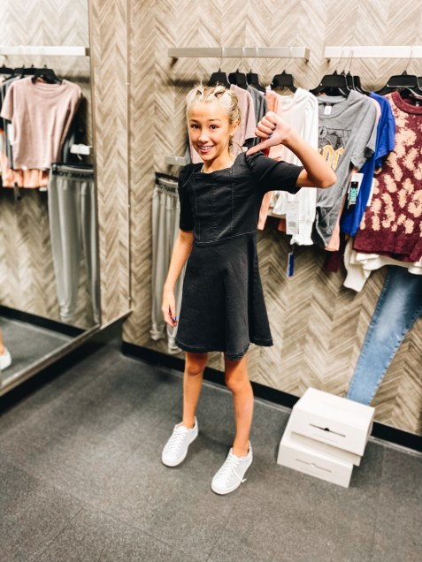 Nordstrom Anniversary Sale 2021: Try On Edition featured by top Pittsburgh fashion blogger, Fashionably Late Mom   Nordstrom Anniversary Sale by popular Pittsburgh fashion blog, Fashionably Late Mom: image of a teenage girl wearing a Nordstrom black dress and white sneaker.