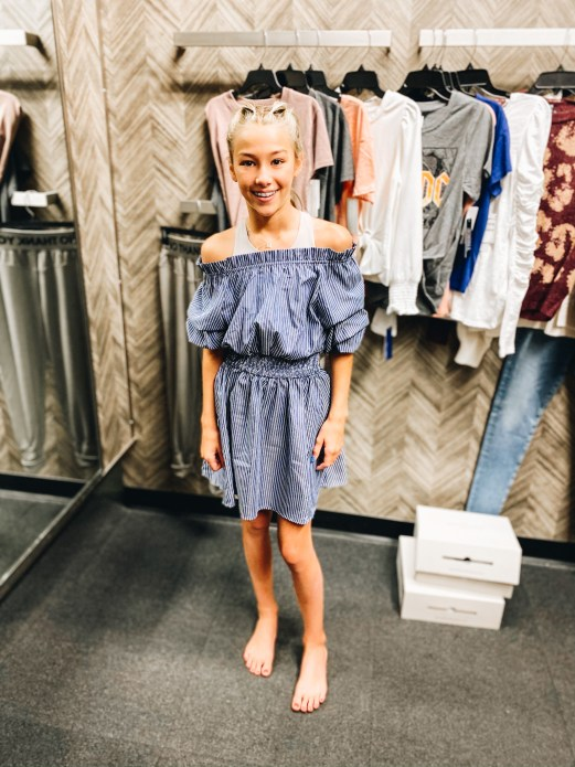 Nordstrom Anniversary Sale 2021: Try On Edition featured by top Pittsburgh fashion blogger, Fashionably Late Mom   Nordstrom Anniversary Sale by popular Pittsburgh fashion blog, Fashionably Late Mom: image of a teenage girl wearing a Nordstrom off the shoulder blue and white stripe dress.