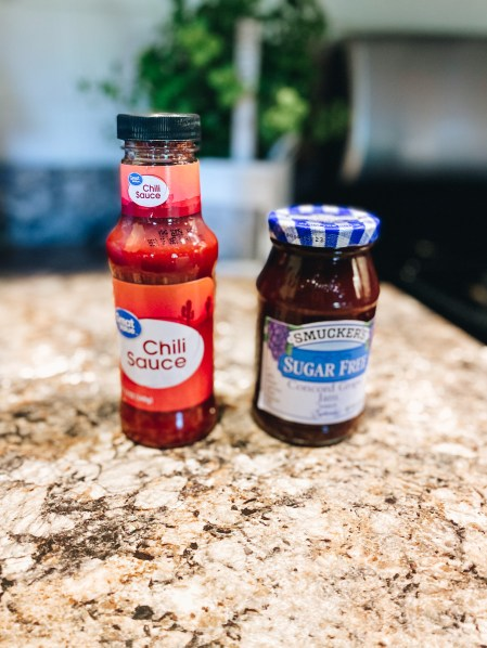 meatloaf sauce | Sweet and Spicy Meatloaf by popular Pittsburgh lifestyle blog, Fashionably Late Mom: image of chili sauce and concord grape jam.