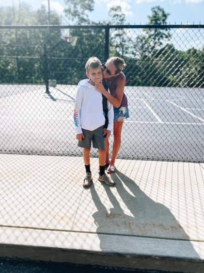 back to school fashion for boys, abercrombie kids, target for kids, boys style   Back to School Outfits by popular Pittsburgh fashion blog, Fashionably Late Mom: image of a mom kissing her son on the cheek while they stand next to an outdoor basketball court.