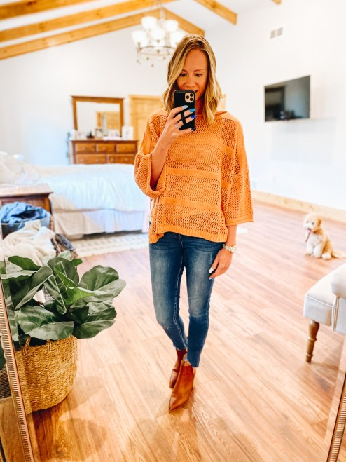 poncho, fall style, kut from the kloth jeans, business casual outfits, working mom fashion | Working Mom Outfits by popular Pittsburgh fashion blog, Fashionably Late Mom: image of a woman wearing a orange knit poncho, jeans, and brown ankle booties.