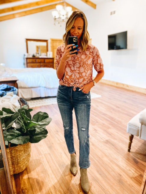 working mom fashion, fall floral, crop straight jeans, booties, business casual | Working Mom Outfits by popular Pittsburgh fashion blog, Fashionably Late Mom: image of a woman wearing a fall floral crop top, distressed jeans, and tan suede ankle boots.
