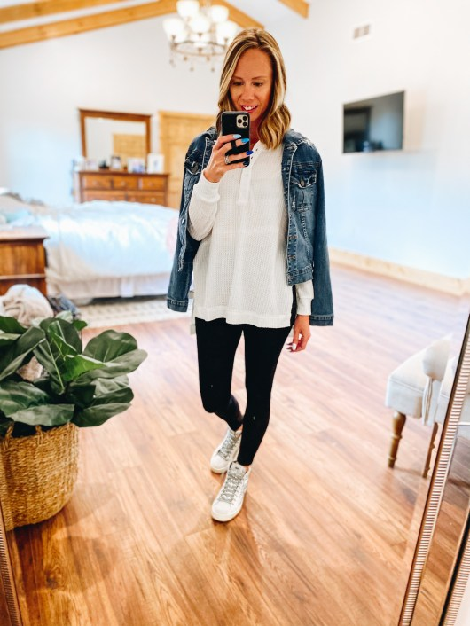 fall fashion, denim jacket, spanx leather leggings, | Gibson Clothing by popular Pittsburgh fashion blog, Fashionably Late Mom: image of a woman wearing a white long sleeve knit top, black Spanx leggings, BP sneakers, and a denim jacket.