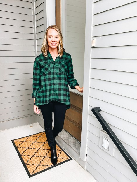Pink Lily by popular Pittsburgh fashion blog, Fashionably Late Mom: image of a woman wearing a Pink Lilly  green and black buffalo plaid button up, black jeans, and black ankle boots.