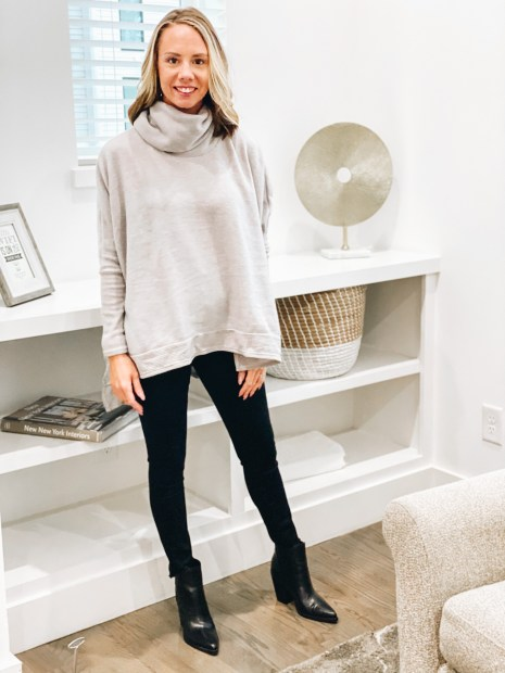 Pink Lily by popular Pittsburgh fashion blog, Fashionably Late Mom: image of a woman wearing a Pink Lilly  grey cowl neck sweatshirt, black jeans, and black ankle boots.