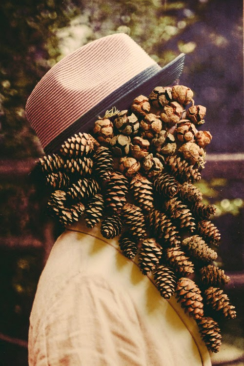 """Visible  by Giacomo Favillaon Behance  """"Visible"""" is the second collaboration between Italian duo, Giacomo Favilla and Francesca Lombardi.  Favilla, whom is a photographer, and Lombardi, a designer, combine their works to create a unique dialogue between the traditional 2D view of photography and 3D materials of craft.  Male figures are posed wearing special hats on their own background, with their identities hidden and transformed into pure organic masks. Favilla shoots his photography with elements inspired by nature, while Lombardi works as a collector and redraws the features through collages of organic objects, with a goal to create a special link between atmosphere and matter.  Hats: Dasmarca London"""