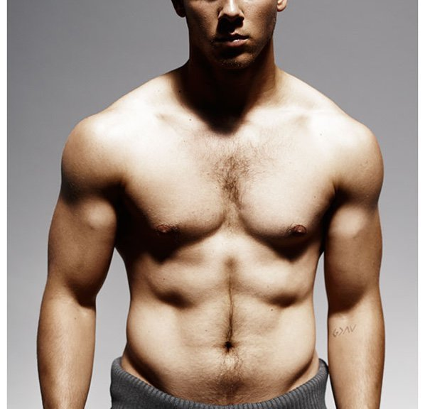"Details shares outtakes from its photo shoot with Nick Jonas for its November 2014 issue. Promoting Kingdom, where he plays a fighter, Jonas had to pack on pounds of muscle. Talking to Details, Jonas explains, ""I had about six weeks to put on 12 to 15 pounds of muscle before filming started on [DirecTV's] Kingdom–my character is a fighter whose strong suits are wrestling and grappling. Diet had a lot to do with it. I went from consuming about 3,000 calories a day to 4,200! Paleta, a food-delivery service, sent me three meals a day and snacks. It was an incredible way to know that I was getting what I need to build muscle and not have to think about it. Breakfast was usually an omelet with veggies and cashew cheese, a turkey-meat patty, and some fruit; lunch and dinner would be lean protein, veggies, and nuts; snacks consisted of things like snap peas with peanut sauce."" Read more at Details.com."