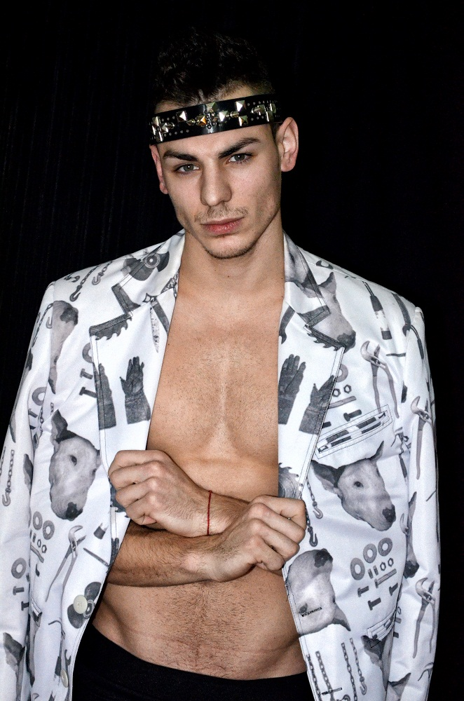 Following a really spicy mood photographer and stylist beloved friend Srdjan Sveljo focuses his lens on fresh face Goran Z. The young up and comer hits the studio for a simple shoot, posing against a dark background. Outfitted by stylist Srdjan Sveljo, Goran wears several loungewear, provocative underwear from Papi with vintage tops and classic jackets.
