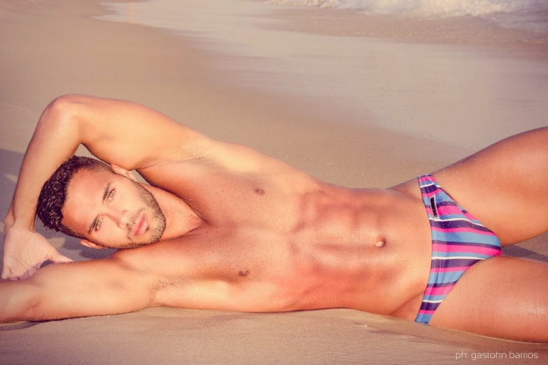 Definitely this is a beautiful work by Photographer Gastohn Barrios and sexy male model Ramon Jorge a Brazilian stunner modeling in the beautiful place named Grumari Beach at Rio de Janeiro. Beyond excellent portrait and video, this is our favorite beach session we've ever seen in years.