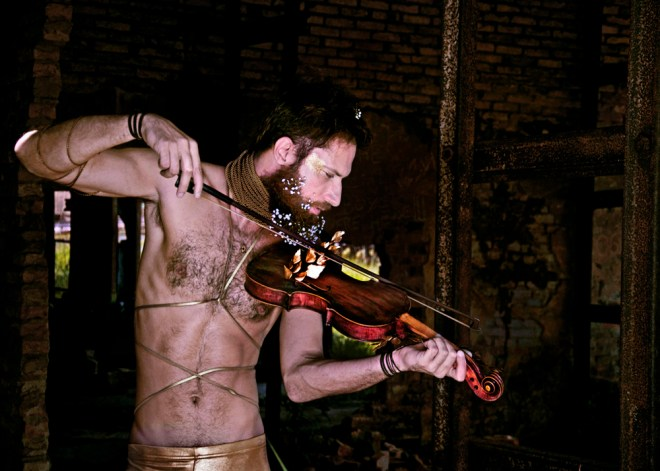 "The concept for this editorial is inspired by the book ""The Auschwitz Violin"" by Maria Angels Anglada. Her historical narrative depicts the hopes of Daniel, a Jewish craftsman, who, amid the horror of genocide within an Auschwitz concentration camp at the time of the Holocaust, seeks salvation through his gift and passion in the art of building violins. His efforts to achieve musical perfection by creating a sound, pure and precise, was implicit to his survival of the day to day horror of the gas chambers. The photographic work within this editorial explores the metaphorical concept of a unique, poetic and sublime pain. The guilt of survival and fear of impending death are intertwined in this emotional portrayal, which reflects upon the timeless inspiration of art, music, poetry, fashion and literature, and captures the essence of the artist's cultural and social contribution, undeterred through hardship. The sentiment of this work transcends time, reflecting on a cruelty somewhat incomprehensible to the contemporary world but reminiscent of current ongoing cultural, political and humanitarian crises. The dichotomy of gold and black within this editorial, superficially whimsical yet with a dense and heavy undertone, is inspired by the designer Thom Browne, based on his winter 2016 Paris collection. The golden colors seemingly predominate in certain frames but express a cold opulence, representing Kanadá, items taken from Jewish prisoners considered to be of value, such as money and gold (including the gold teeth of victims), which were sent directly to the German Central Bank. Black colors represent the bleak authoritarianism of Nazi Germany and, amid the darkness, we are reminded of the slavery and encouraged to mourn for one of humanity's darkest times. Nudity in this work emphasises the torment and undignified death of the innocents who died inhumanely during these atrocities.  Credits Model: Diego Volpi (L'Equip Model & Arts Brazil) Photography: Katia Reis Executive and Lighting Production: Anderson Henrique Rodrigues Art Direction/Styling & MakeUp: Evandro Gueiros PhotoRetouch: Evandro Gueiros  Brands: American Apparel, Zara Men, Diesel, Caras Kaytara, Mário Queiroz, Gisele Bündchen for C&A, Cat, Galeria do Rock, Zoomp, AllSaints, TopMan"