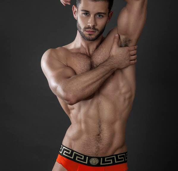 Stunner hunk male model Adam Phillips is posing in the studio for the lens of Joe McCormick. Adam looks so handsome, better than ever.