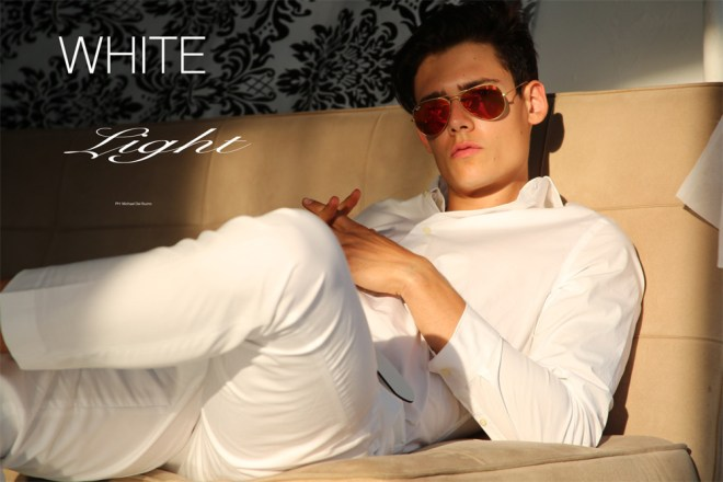 "Delighting with his presence we have an exclusive featuring for Fashionably Male, here's Mario Adrion at One MGMT exquisite portrait by talented Michael del Buono. Mario in ""White Light"" story charming in a full white suit by Express and underwear by Emporio Armani."