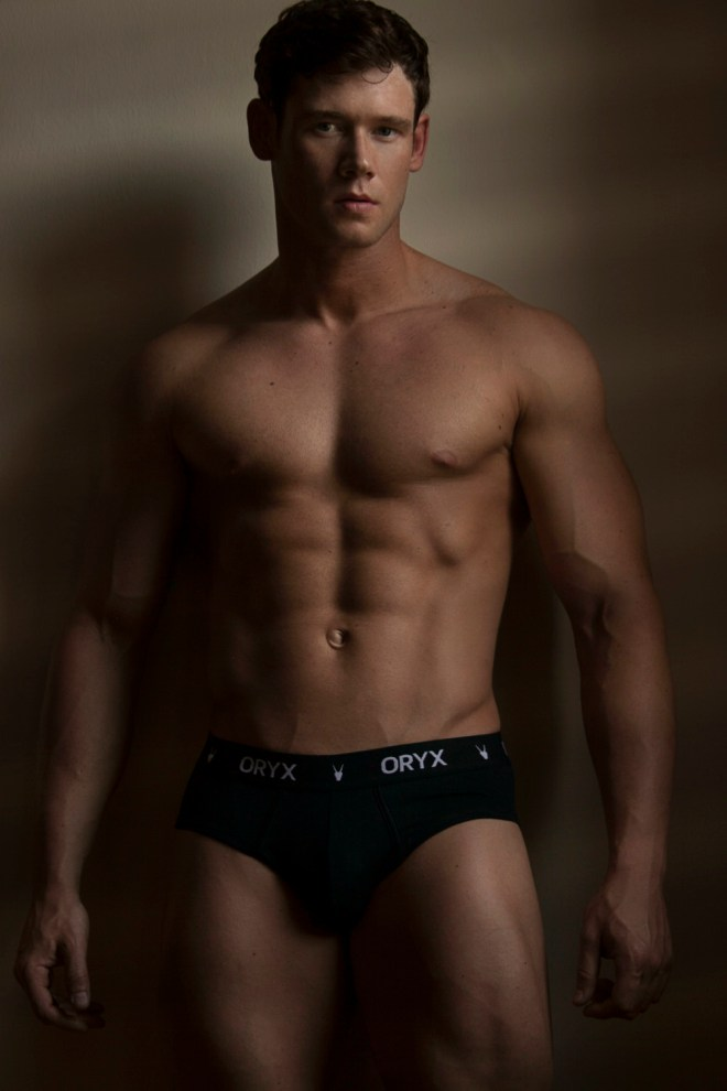 Incredible shot by Sean Gomes featuring hunk fitness male model Brian Lewis.