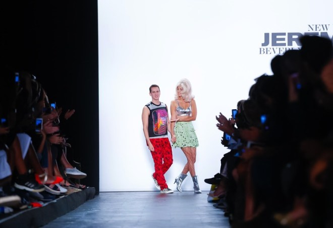 "Jeremy Scott, fashion's perennial club kid class clown, has graduated to prom king. He's resuscitated Moschino, dressed pop princess Miley Cyrus for the media maelstrom of the MTV VMAs and been the subject of a buzzy documentary, ""Jeremy Scott: The People's Designer,"" premiering in New York Sept. 15. He's made skeptics laugh and smile and have fun with his clever gags; now they expect it. Have the antics become an albatross?"