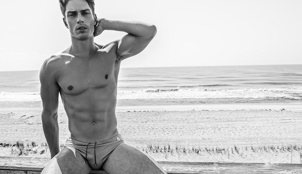 Exclusive for Vulcan Magazine, dashing male model Matthew Ludwinski posing marvelous by Kamera Addikt. Swimwear: Slick It Up.