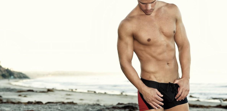Spotlighting fitness male model Shawn Alexander wearing Ergowear pieces posing for the lens of Armando Adajar.