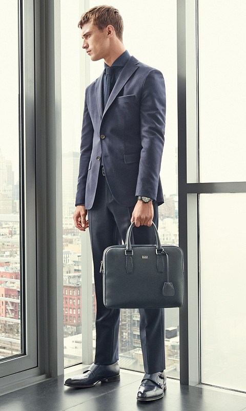 Leading model Clément Chabernaud is once again the man of the season for Hugo Boss, posing for the German label's winter campaign. Playing the role of the sophisticated businessman, the French charming face embraces a smart wardrobe of sharp formal styles, while the brand's leather goods add to the styling of the images a precise personality.