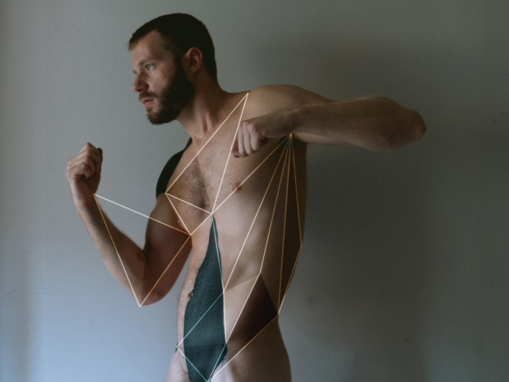 """Erik Lazarini a whispered mind and photographer in NYC who showing off an artsy photography entitled """"Lines and Shadows"""" a beautiful set and natural lighting and featuring Mitch Mathias all eyes on shapes, lines and muscles."""