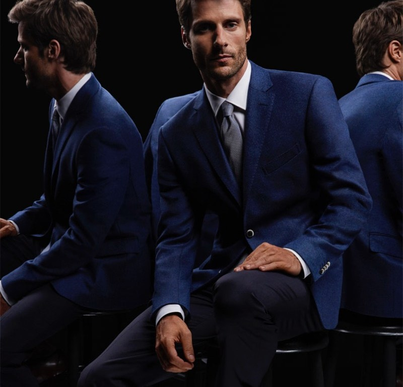 View Management model Tommy Dunn stars in the latest Holiday 2015 cataloge for El Palacio Del Hierro. The model poses for David Roemer wearing the suits from labels such as Cerruti 1881, Lauren by Ralph Lauren and Michael Kors.