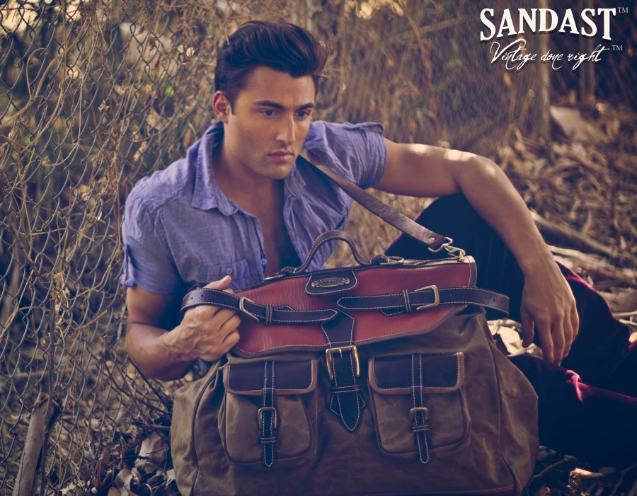 Modeling in the new promotional ad shots John Strand (Aston Models) for Sandast LA started in 2010 to create the finest leather bags and accessories, captured by Via Aclan.