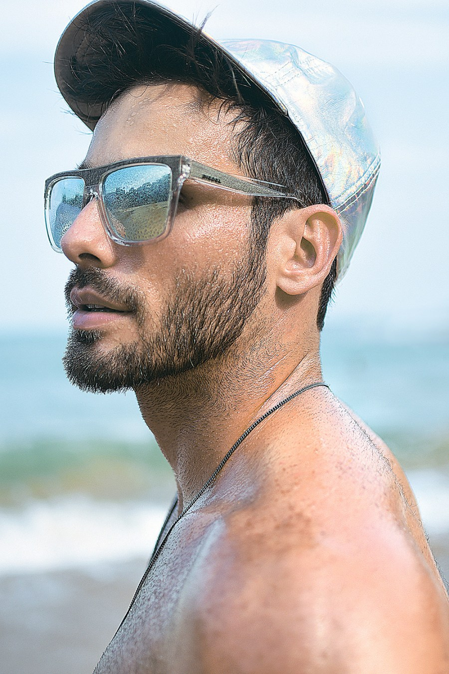 The seductive Brazilian model Maurico Junior is photographed by Tati Rangel for jeanswear editorial on the coast of Espírito Santo.