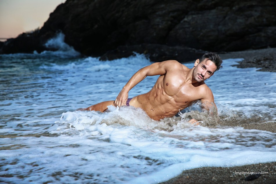 Striking Spanish fitness model Jairo Alcalde build ups his portfolio with Malaga based photographer LM Gómez Pozo out in the sea.