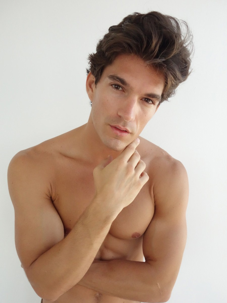 Fretting digitals in Next Models Miami, here's David Sanz 6'0 of toned beauty.