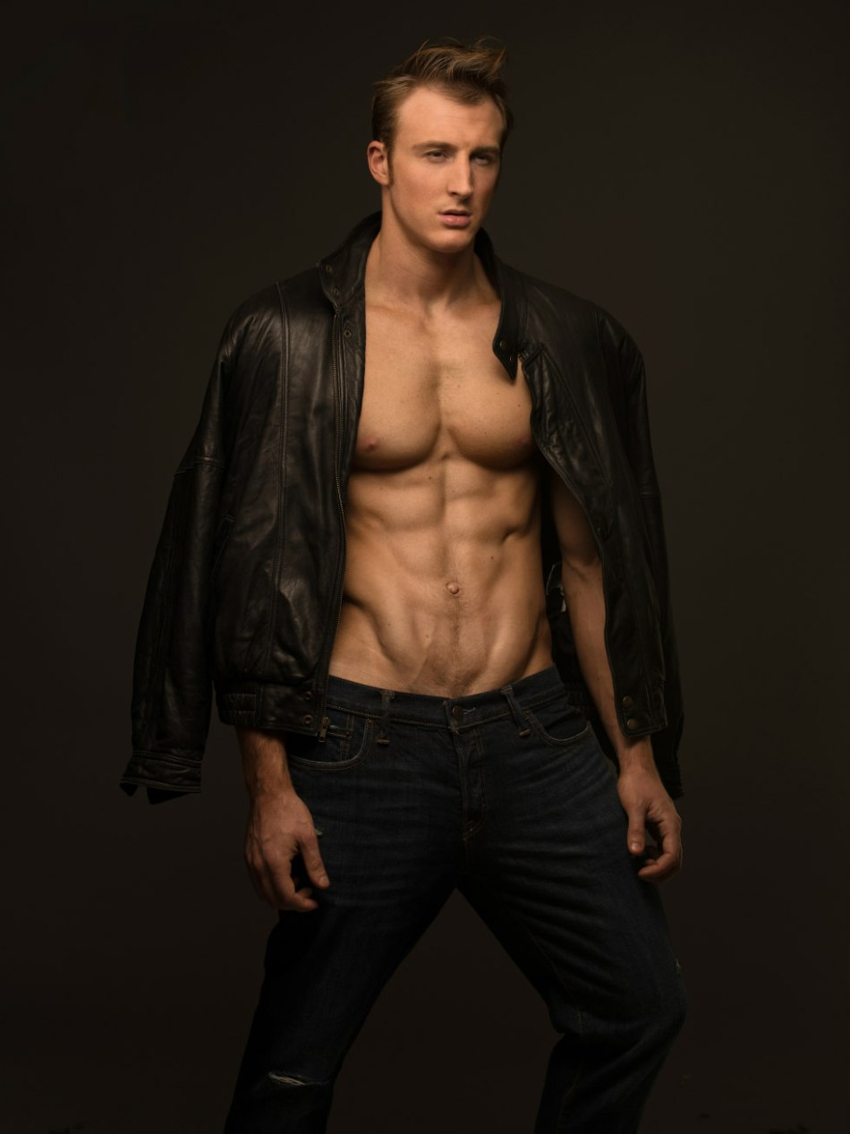 Fitness model Mike Vona is here with us in this study shot by photographer Jade Young. Mike possess a built strong male figure with dashing melting eyes and face.