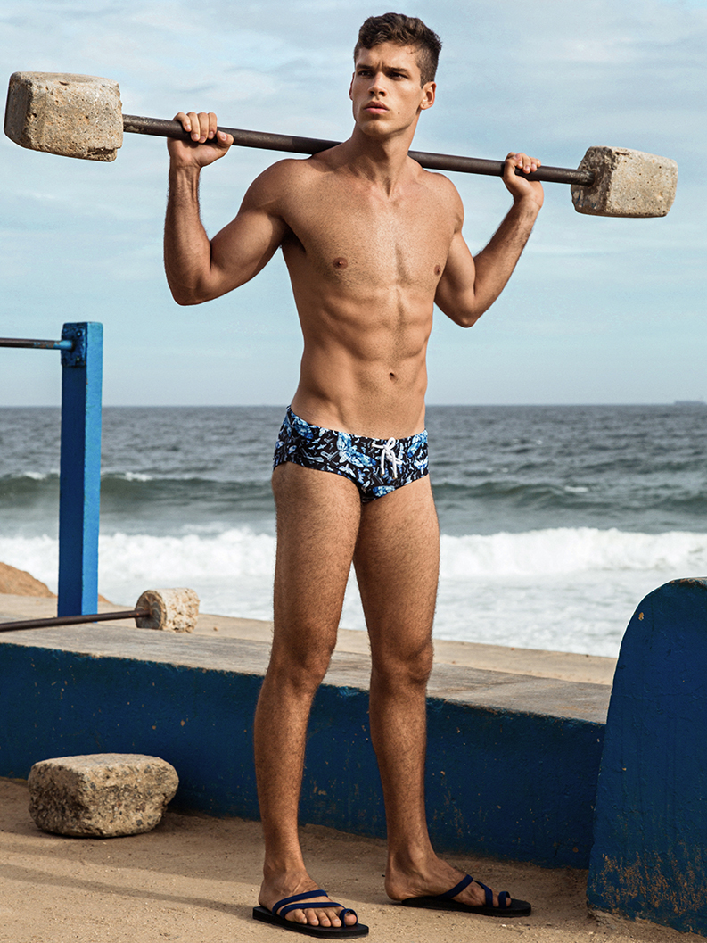 Photographer Ted Sun enjoys a day at the Arpoador Park in Rio de Janeiro with a new shoot featuring model Gabriel Loureiro. Seeking out a variety of swim shorts and board shorts for the upcoming summer season, Gabriel is wearing the newest pieces by Parke & Ronen, Danward and Charlie by Matthew Zink.