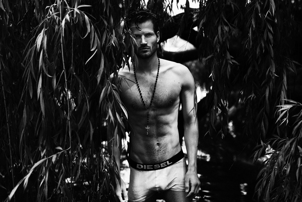 Provocative dark images of David Koch by Sebastian Hildetag shooting in Berlin. The model is posing provocative in white trunks by Diesel outdoors while Hildetag capture every moment.