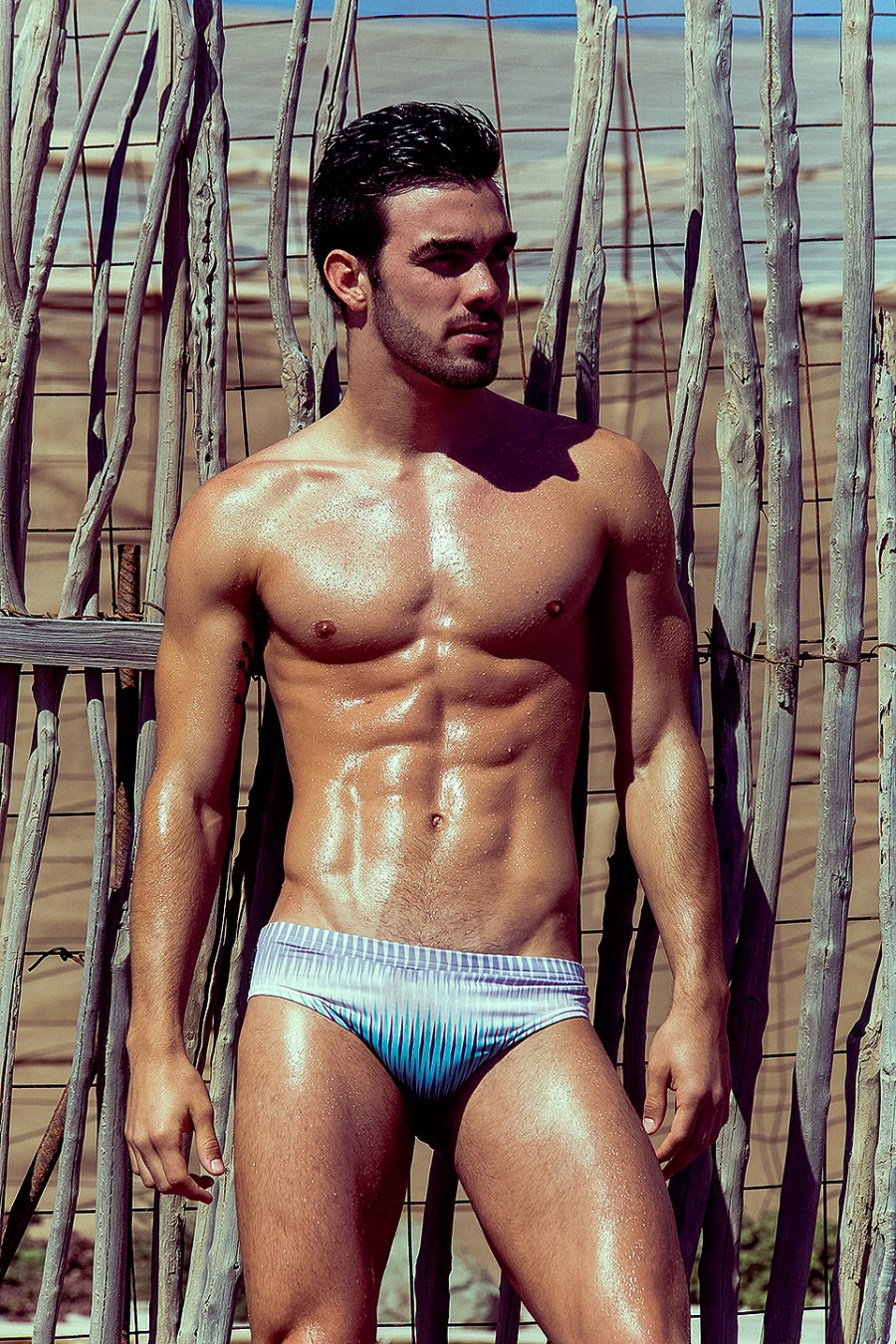 We can blame to photographer Adrián C. Martin for capturing this hunk sexy new comer Tomás Perez a Professional Waterpolo player and model, wearing pieces from Manus Swim, Shot in different locations of Gran Canaria, Canary Islands.