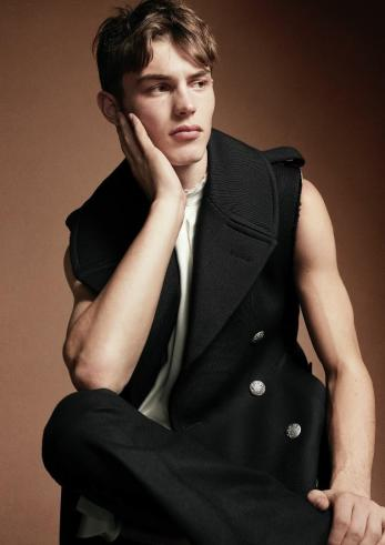 Alexander McQueen silk shirt and sleeveless wool coat and trousers.