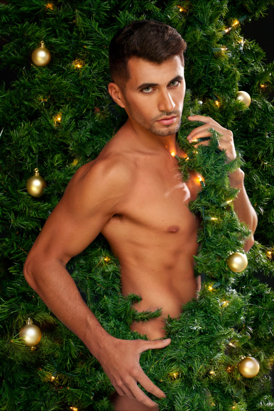 Merry Christmas! 🎄🌟 All wrapped up and ready to go - JONO Photography comes to Fashionably Male wishes to all of us a Merry Merry Christmas featuring male Marcio Carvalho shot in the studio lighting our hearts.