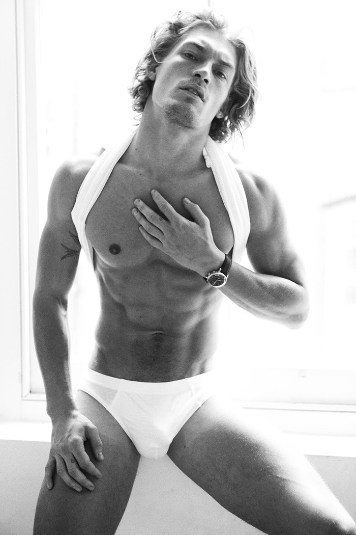 Harry Goodwins flaunts his new even-buffer physique in the latest issue of Wonderland Magazine. The British model wears white briefs, jeans and shirts styled by Kamran Rajput in the black and white images shot by Bartek Szmigulski.