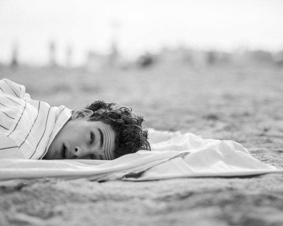 Sleeping On the Beach   V MAN