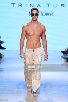 A model walks the runway for Trina Turk at Miami Swim Week powered by Art Hearts Fashion Swim/Resort 2018/19 at Faena Forum on July 14, 2018 in Miami Beach, Florida.