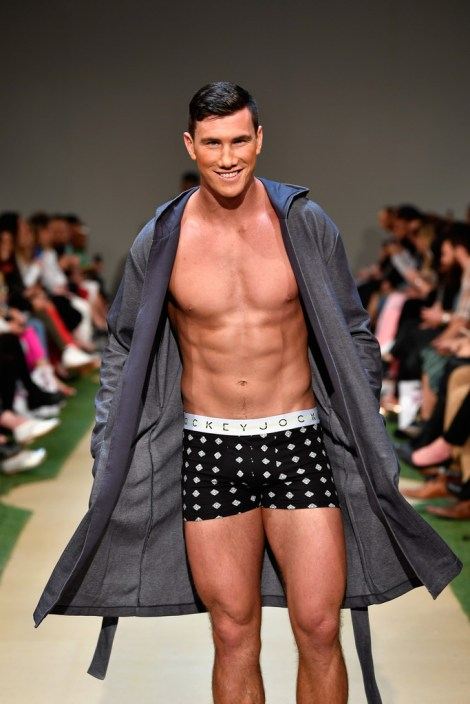 Sam Dickson of the New Zealand rugby sevens team walks the runway during the Jockey show during New Zealand Fashion Week 2018 at Viaduct Events Centre on August 30, 2018 in Auckland, New Zealand.