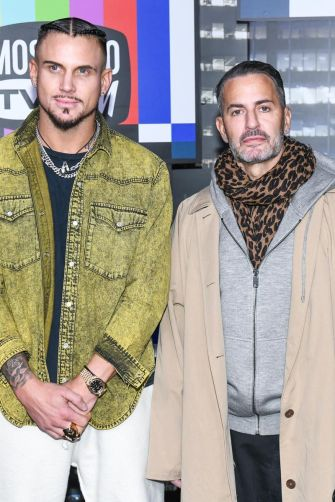 Marc Jacobs and Char Defrancesco attend the Moschino x H&M runway at Pier 36 on October 24, 2018 in New York City.
