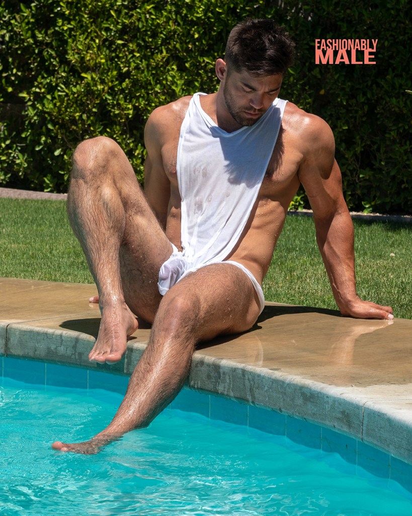 muscle model poses in the edge of a swimming pool