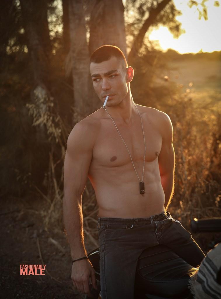 Male model shirtless smocking