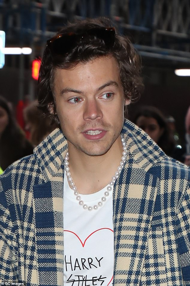Harry Styles wearing pearls
