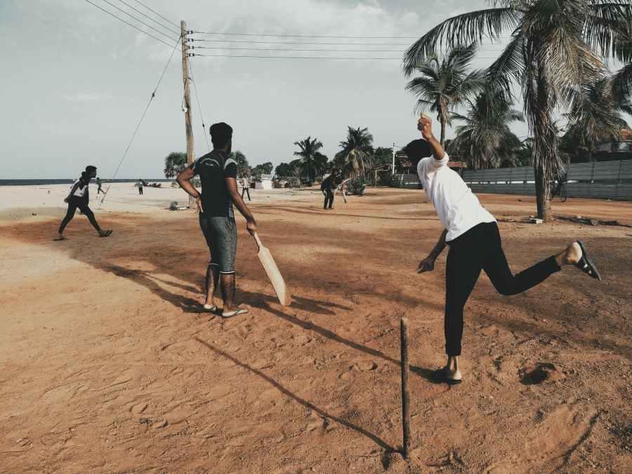 men playing cricket at beach Photo by MAM Ashfaq on Pexels.com