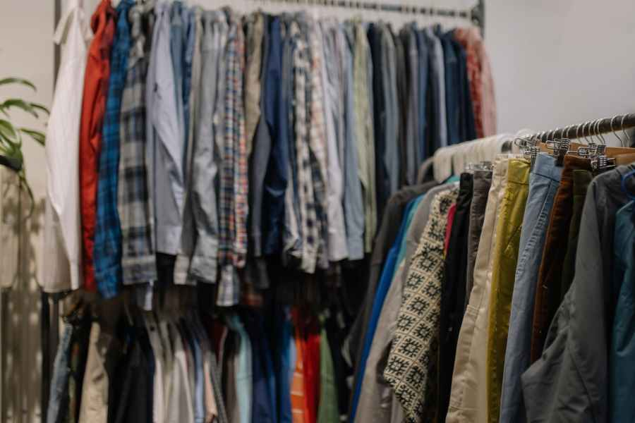 assorted clothes hanged on clothes rack