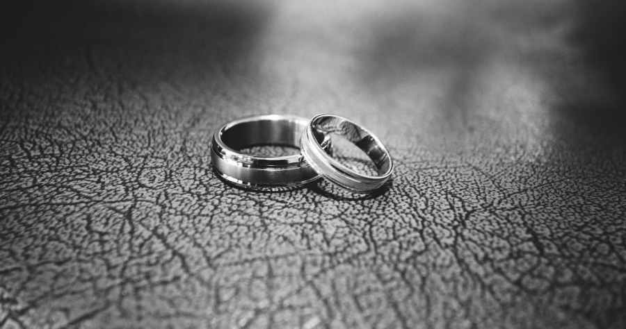 close up of wedding rings on floor. Photo by Megapixelstock on Pexels.com