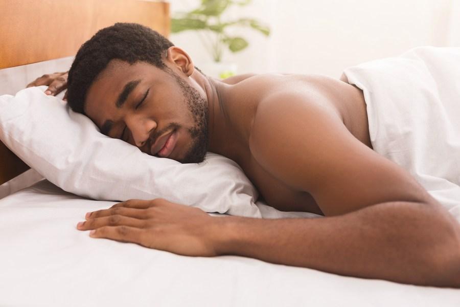 Reasons to get Organic Mattress. Guy sleeping in organic mattress.