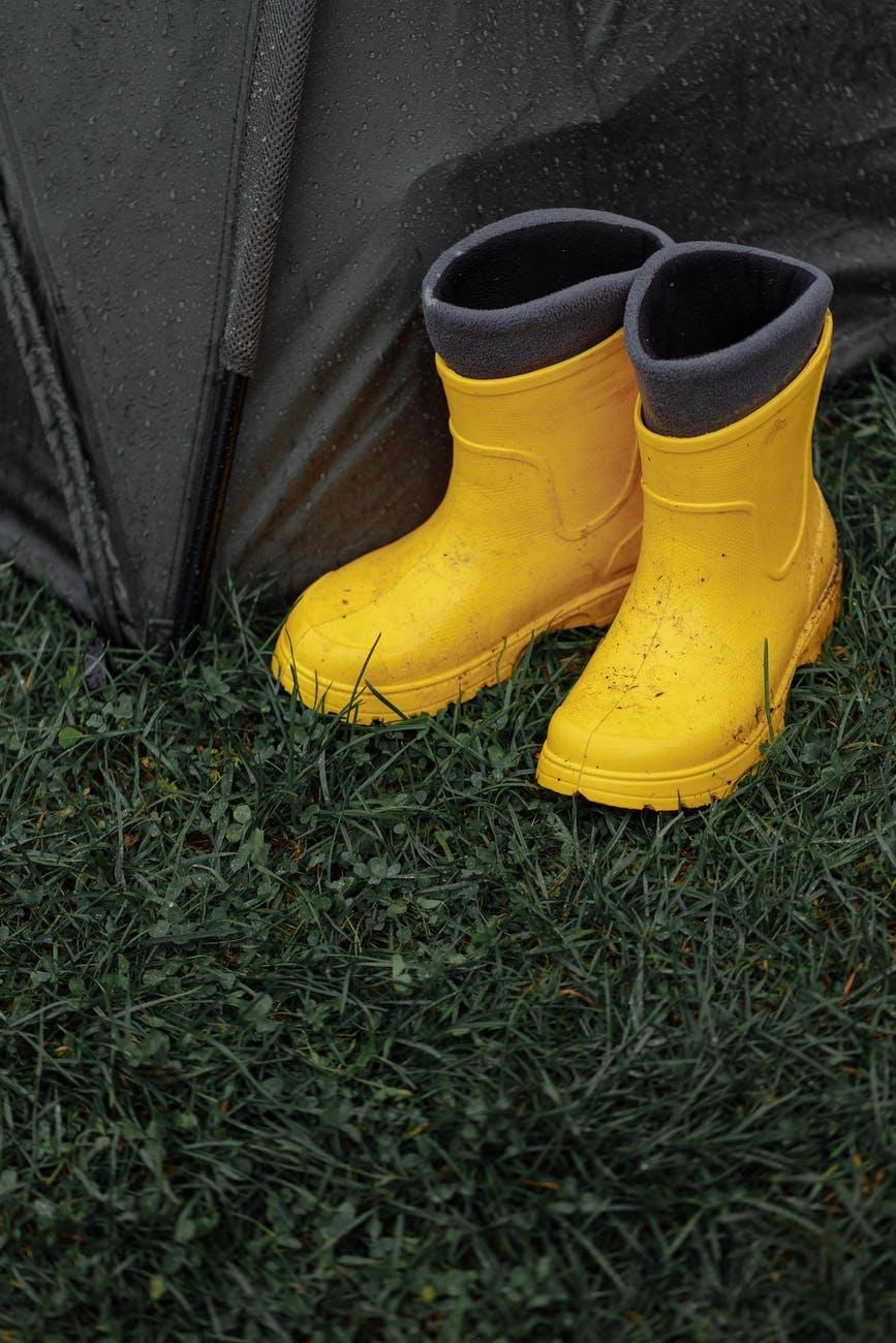 yellow rain boots on green grass. Photo by Thirdman on Pexels.com