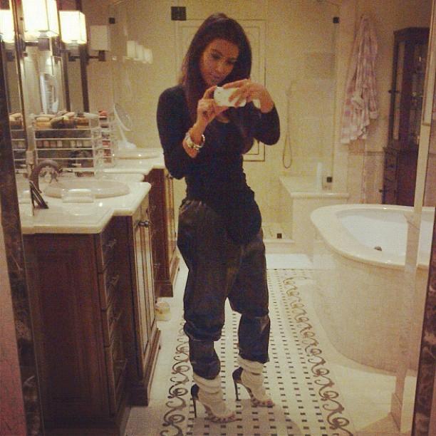 Kim-Kardashian-wearing-Helmut-Lang-shirt-Celine-leather-sweatpants-Kanye-West-for-Giuseppe-Zanotti-heels-