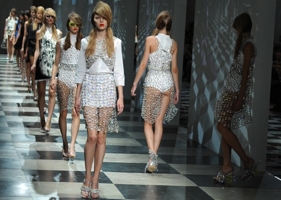 Models display creations of Prada Spring