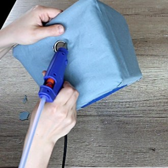 Recovering storage bins with fabric